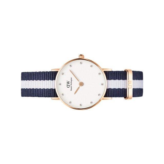 Orologio da donna Glasgow Classy dorato, firmato da Daniel Wellington, con cinturino navi colore blu e bianco. Un classico sportivo per donne moderne in vendita on line sul nostro shop.