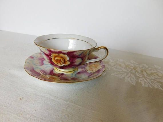 "Handpainted cup and saucer in a pink floral design, gold accenting   The cup is 2 3/16"" (5.6 cm) high x 3 7/8"" (9.8 cm) at the brim and the saucer is 5 1/2"" (14 cm) in diameter   This set is in very good condition and only appears to have seen use as a collectible   Made of china by Shafford    This item has no nicks, chips, cracks, or signs of repair 