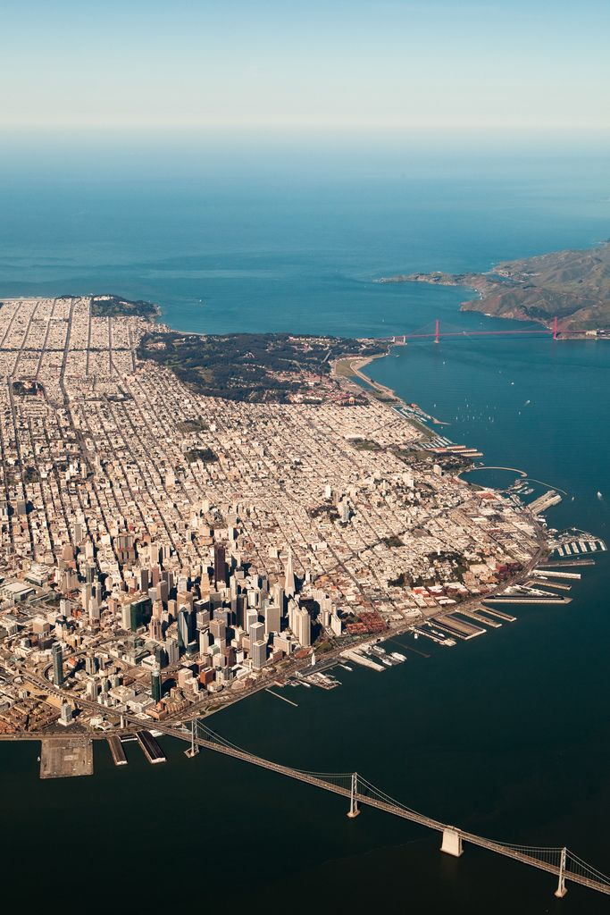 San Francisco, CA. See the Golden Gate Bridge at the mouth of the Bay and the Bay Bridge from Oakland in the foreground