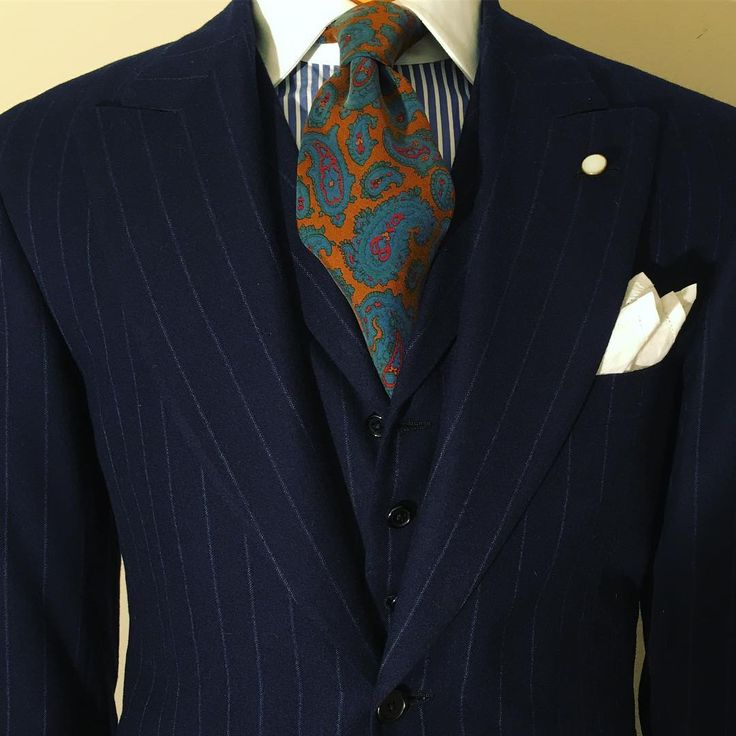 A most compatible pairing: proper English flannel and hand-blocked 40 ounce gum twill silk. The rich, matte finish of two diverse cloths results in a most pleasing visual. The printing of the finest silk neckwear is a taxing, labor intensive task. There is an individual screen for each color, and all are hand applied. Most designs consist of three to four colors; this one, however, has six. Silk absorbs dye like no other fabric, yet it is also highly delicate. The special dyes used by…