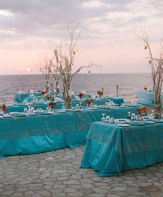 love the turquoise covered tables