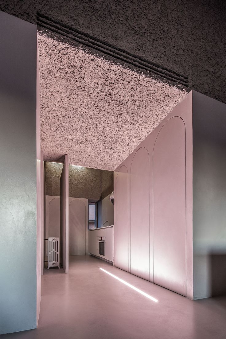The House of Dust (Rome 2013) is an architectural work designed by Sicilian architect Antonino Cardillo: pink light in the entrance at the night. Photography by Antonino Cardillo.