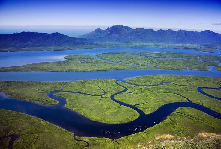 Hinchinbrook Island lies east of Cardwell and north of Lucinda, separated from the northern coast of Queensland, Australia by the narrow Hinchinbrook Channel.