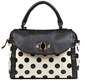 Vintage-style Handbag Available in Black-and-white Polka Dots.* *Selected stores only.