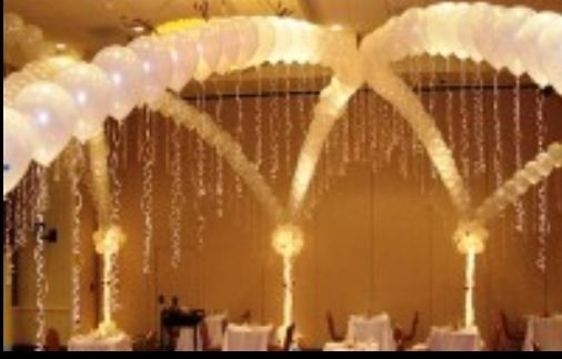 maybe guests hold up a line of LED balloons to walk under??