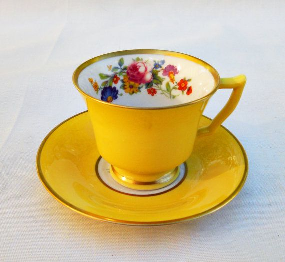 Beautiful yellow tea cup and saucer from the 1920s. In perfect condition! Great addition for any collector of demitasses or tea cups. If you