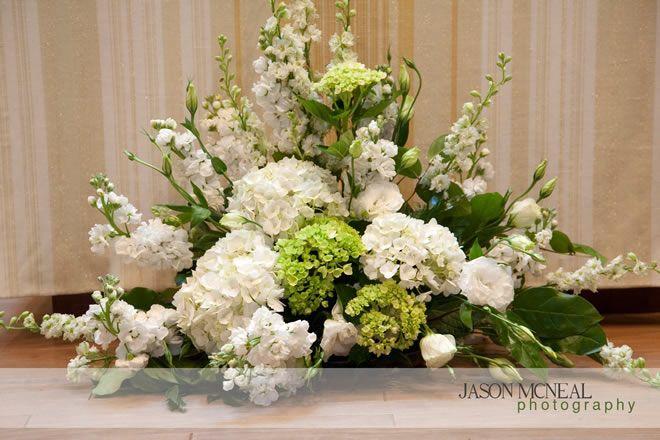 Google Image Result for http://ashleysbrideguide.com/images/uploads/altar-flowers-nashville-wedding-2.jpg