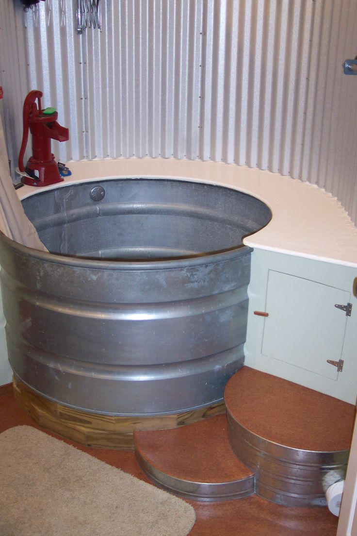 tub and shower created from a stock tank from the mind