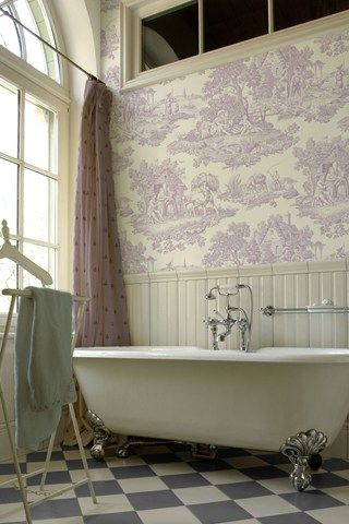 Smitten with: toile wallpaper, transom windows, faucet placement on the tub.                                                                                                                                                      More