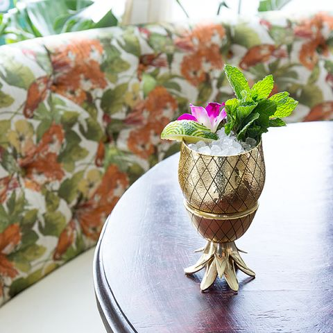 THE PINEAPPLE HAS LONG BEEN RECOGNIZED AS A SYMBOL OF HOSPITALITY AND WARM WELCOME. WELCOME OTHERS TO YOUR HOME WITH THIS TWO-PIECE BRASS PINEAPPLE TUMBLER, A U