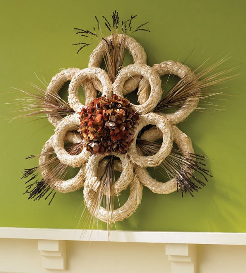 Straw Wreath How-To.  Join straw wreaths with twine and add floral accents to make a big design statement.