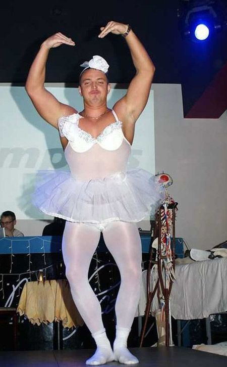 Funny picture of a guy with a frilly white tutu on. He should have known this pic would make it to the internet.