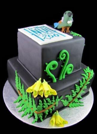 Two tiered native flora and bird cake - by Eat Cake (Auckland).  Tui,  Kowhai, Fern, Koru, Black.