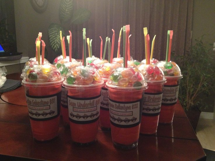 A rolled team t-shirt in a cup, topped with candies and pixie sticks. Gifts for a boys hockey team.