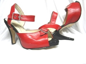 "4"" Calesita - Tango Shoe -- Red/Black  INFORMATION: Leather upper, leather sole. Classy, stable heel, and comfortable. Adjustable buckle ideal for wider feet. Ideal for streetwear or tango dancing. Made in Argentina. Original Robin Tara dance shoe."