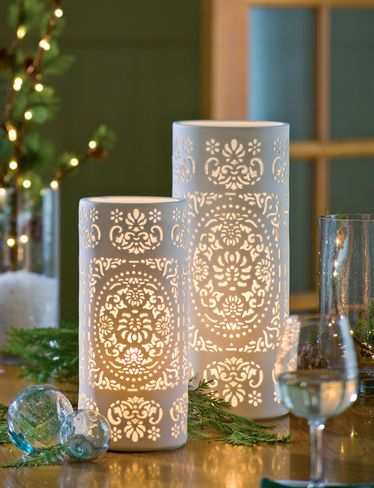 Pierced Porcelain Table Lamps... This can be made! Glass vase with lace wrapped and glued around it. At this site these will set you back $30 - $40 each