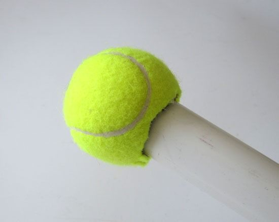 Cover a tennis ball with fabric and use as curtain rod finials. Thrifty DIY Window treatment ideas and drapery rods.