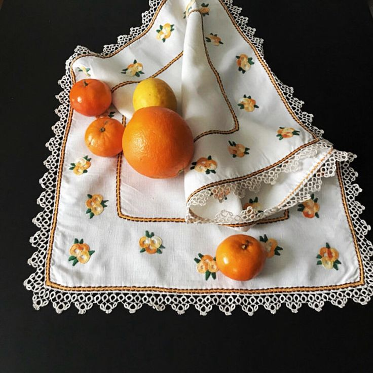 Vintage linen, embroidered tablecloth with orange flowers.