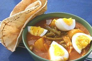 Surinaamse kip met boontjes