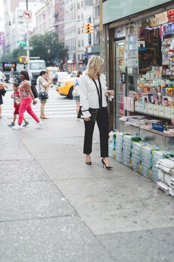 Blogger, Ashley Pletcher browses a newsstand for the latest celebrity gossip while in NYC for NYFW