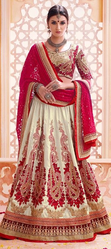 193778 Beige and Brown  color family Bridal Lehenga in Art Silk fabric with Border, Machine Embroidery, Patch, Resham, Stone, Thread, Zari work .