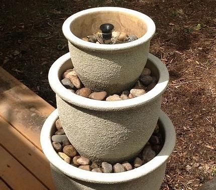 Turn your plant pots into a beautiful garden fountain! Find out how right here!