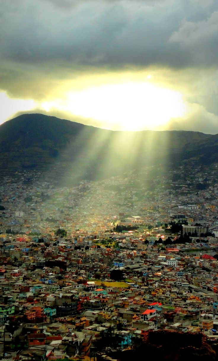 Quito, Ecuador.  go to Otavalo Market in Otavalo (indigenous clothing market) where you can see the views of the Sierra region mentioned above, go to Centro del Mundo (center of the world) which is literally the center of the world -Centro del Mundo is exactly where it passes by.