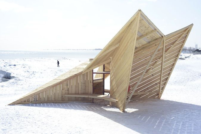 Driftwood Throne: DM_Studio (London) Standing like a sentry on the beach, this angular sculpture assembled from reused timber hides a small bench below a raised viewing platform. Courtesy of Eamon MacMahon .