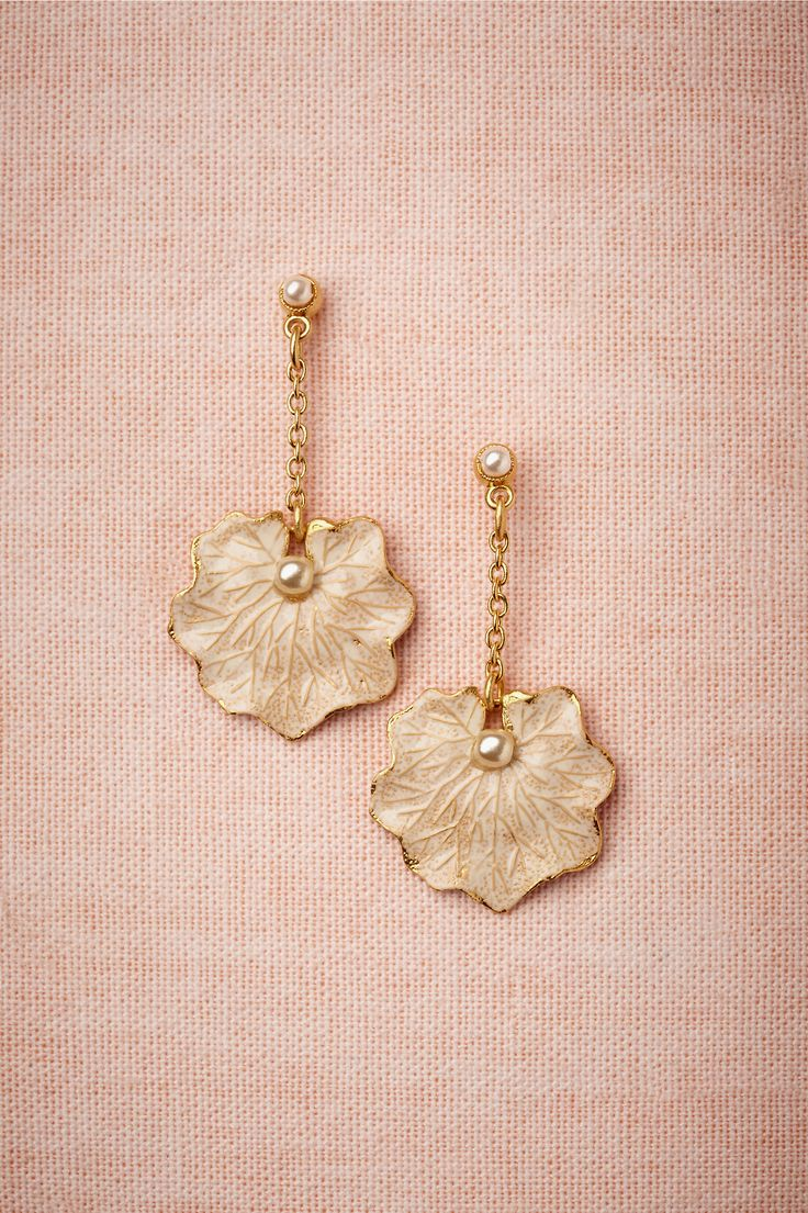 """Lilypad Earrings - Enamel brushed over 14k gold lends a faint blush patina to this pearl-pricked pair. Perfect for the bride, maids, and mothers alike. From Paris by Debra Moreland. 1.25""""L, 0.75""""W. 14k gold plated brass, hand-painted enamel, glass pearl. Handmade in USA."""