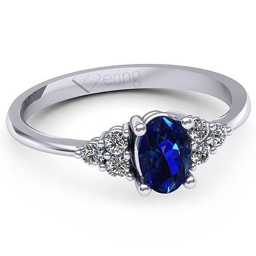 Inelul este realizat din: 1 x safir, dimensiune: ~6.00x4.00mm, forma: oval; 6 x diamant, dimensiune: ~1.80mm, greutate totala: ~0.14ct, forma: round