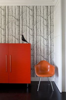 the Eames bird ~ the anthropologie wallpaper ~ the midcentury modern orange chair and cabinet ~ fantastic design