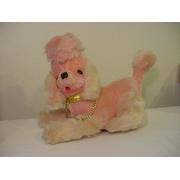 stuffed pink poodle...on our bed! Mine had a radio in it. You controlled it by the dial on it's underside.