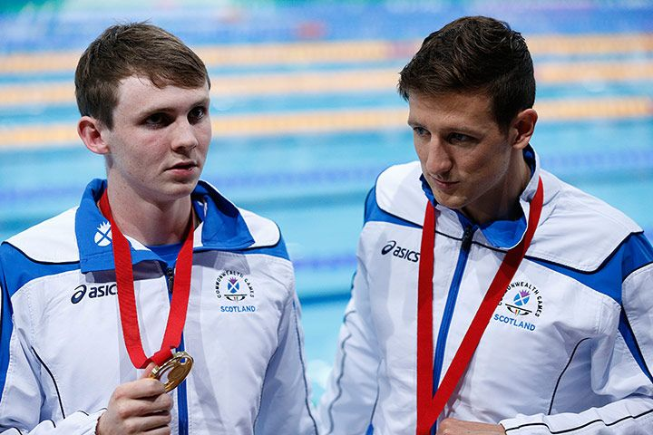 Ross Murdoch still looks bemused after receiving his 200m. breaststroke  gold medal whilst silver-placed Michael Jamieson still looks dejected, Commonwealth Games 2014.