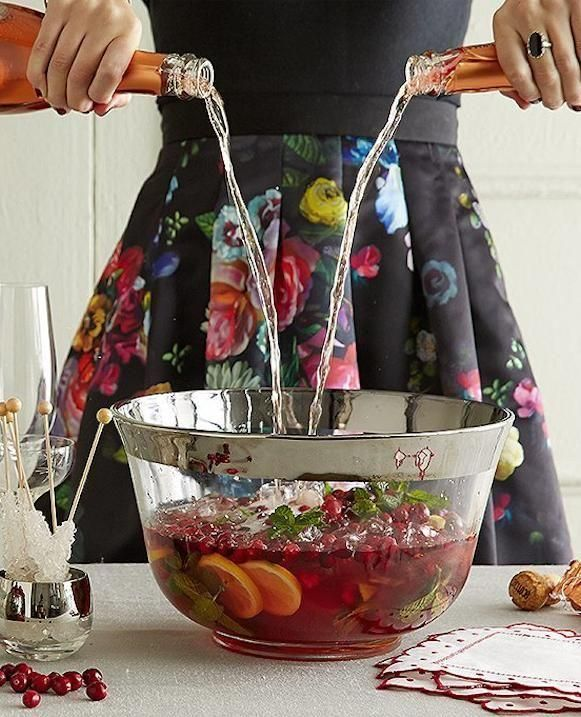 Whats better than a glass of champagne this New Years Eve? Punch, thats what. Punch is back and cooler (and stronger!) than ever. This recipe, which includes champagne, is virtually guaranteed to keep your guests in good spirits, and a bowl of premixed punch lets them help themselves, meaning no endless topping off of glasses for the hostess.: