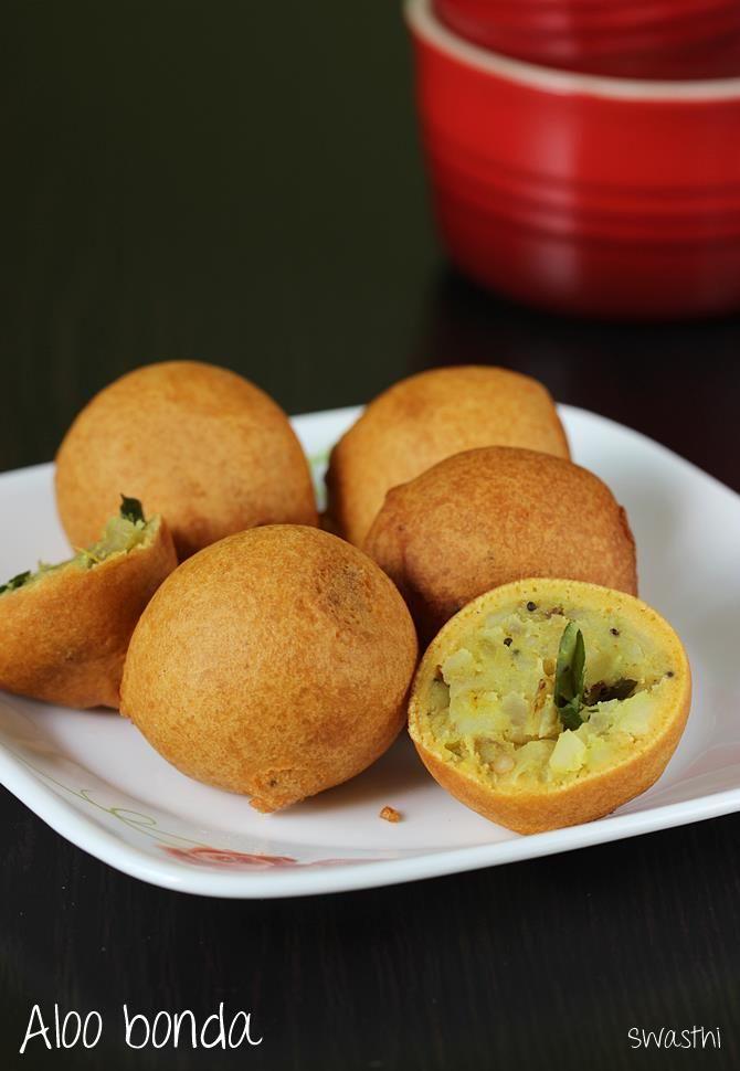 Aloo bonda recipe also called as potato bonda is popular in south Indian states & is often served as a snack with a cup of tea. Potato stuffed bonda recipe
