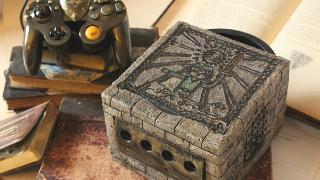 With Hylian numbers showing joystick ports and with an amazing painting of Link on top, artist Vadu Amka's repainted custom The Wind Waker GameCube really looks like some ancient device found at a remote dig site.