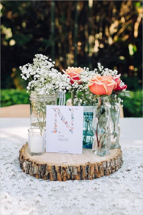 rustic roses and baby's breath with tree stump wedding centerpiece - Deer Pearl Flowers