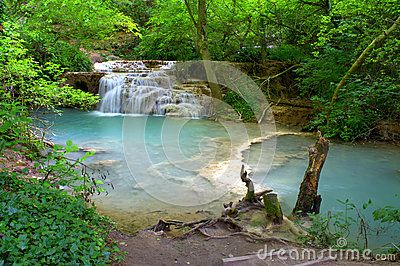 Krushuna Falls is a waterfall in northern Bulgaria, near the village of Krushuna, 34 km from the city of Lovech. They are famous with their picturesque landscape and are formed by many travertines.There is a tourist path leading to the cave where the river springs.