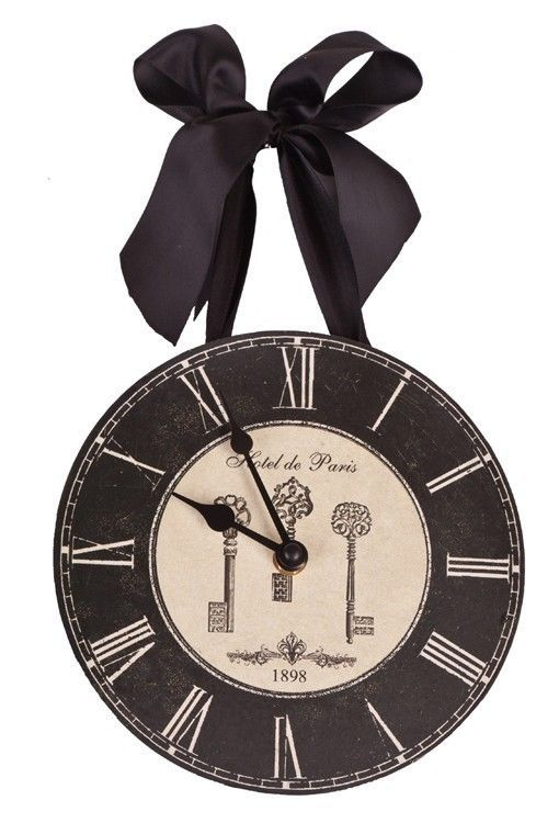 """Clock hangs on wall with black ribbon. We love what we do and it shows as we've been """"loving it"""" for over 14 years. and products so unique they're nearly impossible to categorize. inspirational sentiment gifts and signs. 