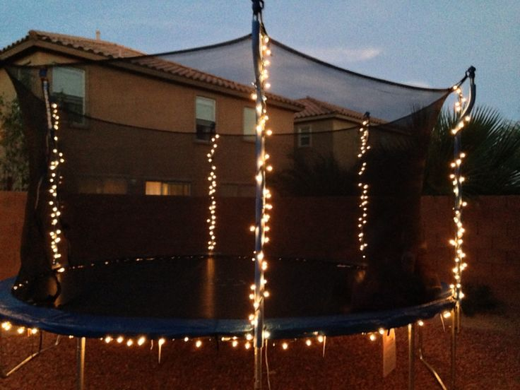 Used Christmas lights to light up my daughters trampoline so she can jump at night , instead of a spot light :) very simple I used three strands of lights and some zip ties for under the pad.