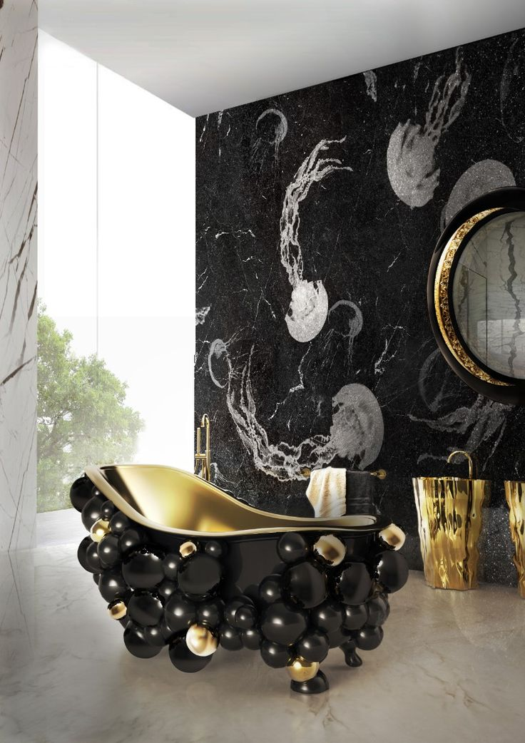 Gorgeous ambiance with a surreal Newton Bathtub over a neutral marble floor and dark marble wall and two Eden Washbasins on the background.
