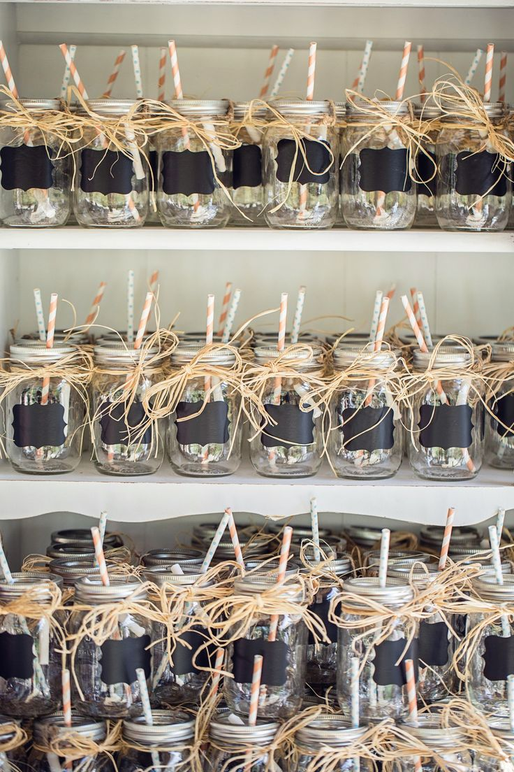 Wedding favor and drinking glass for the night. Mason jars with chalkboard labels, raffia, and twine holding chalk.
