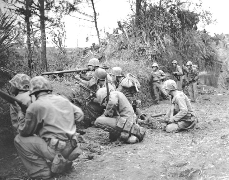 Supported by bazookas, Marines assault a ridge two miles north of Naha on May 4, 1945, during the Battle of Okinawa. U.S. MARINE CORPS