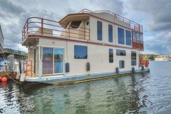 Limbo and Slip ($849,000) - Ultimate Seattle view and executive houseboat (1600+ sf) plus deck space, Hot Tub, 2 living areas, and fully navigable! See it at www.Seattle-Houseboat.com