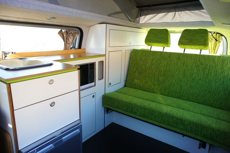 Hyundai campervan conversion with white ply, timber bench top and grass green upholstery.  Social Butterfly campervan conversion with microwave.