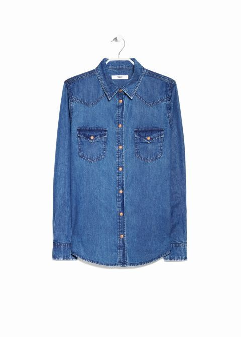 The key to pulling off the Canadian tuxedo starts with having the right top. Shop the 15 best denim shirts, including this Mango Dark Denim Shirt.