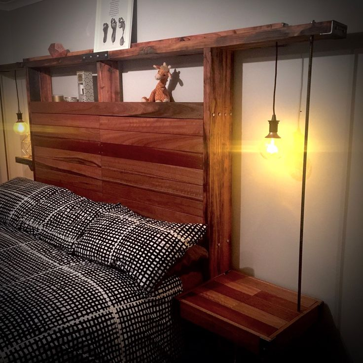 Rustic Bed head from Oregan and hardwood. 2 large fold down storage doors. Built in lights and floating shelves.
