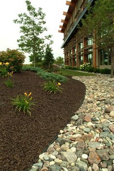 Neat and tidy, I love the look of stones and brown rubber mulch. #mulchonce #notlazy #noweeds #RoosterRubber