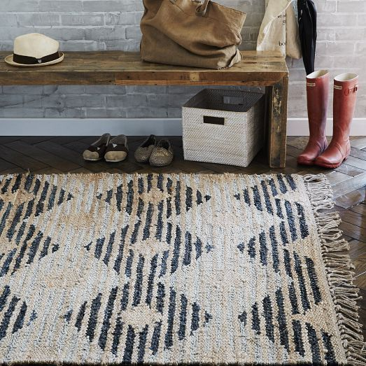 A combination of jute and recycled leather gives this rug a unique, rustic design. Handwoven in India, its durable materials make it perfect for high traffic areas.
