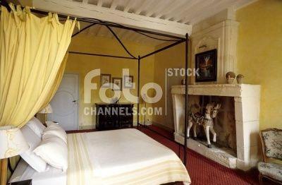 Bedroom, canopy bed, fireplace, historic house, Fontvieille, Arles, Provence-Alpes-Cote d'Azur, Var, Southern France, France, Europe, Numer utworu: IBR0164339, Fotochannels